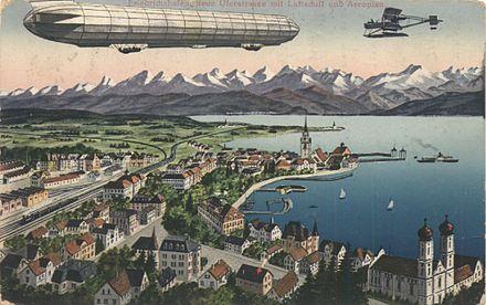 Bild von Friedrichshafen: Postkarte: Neue Uferstraße mit Luftschiff und Aeroplan 1916
